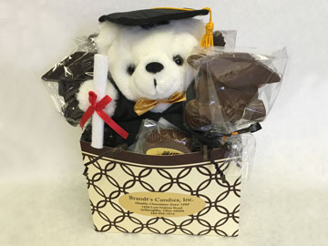 box filled with chocolate and teddy bear for graduation